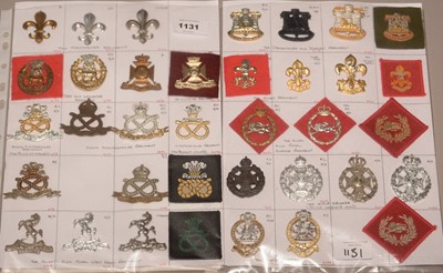 Lot 1131 - A collection of 36 Regimental cap badges.