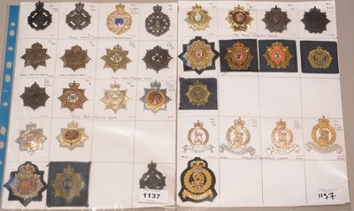 Lot 1137 - A collection of 31 Military Corps cap badges.