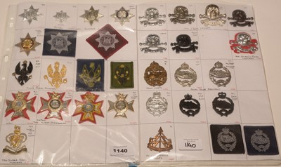 Lot 1140 - A collection of 33 Cavalry Regiment cap badges.