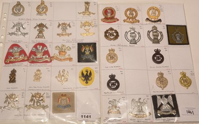 Lot 1141 - A collection of 33 Cavalry cap badges.