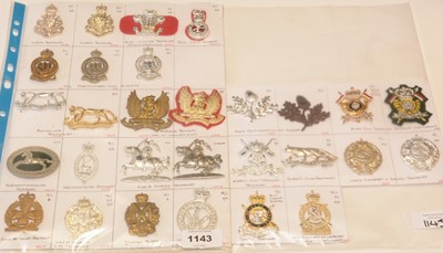 Lot 1143 - A collection of 29 Yeomanry cap badges.