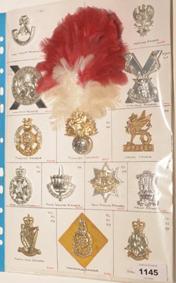 Lot 1145 - A collection of 14 Military Brigade cap badges.
