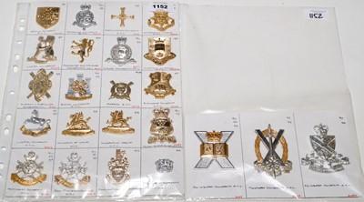 Lot 1152 - A collection of 23 University OTC cap badges.