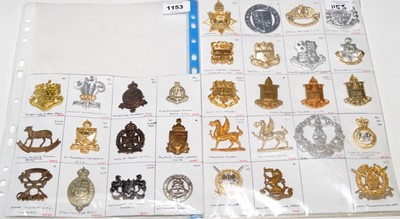 Lot 1153 - A collection of 31 School and Military Academy cap badges.