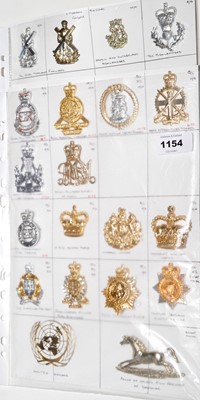 Lot 1154 - A collection of 14 mixed Military cap badges.