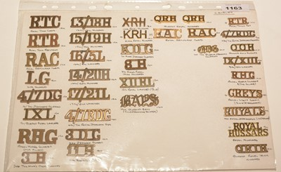 Lot 1163 - A collection of 32 single and 2 pairs of metal Cavalry shoulder titles.