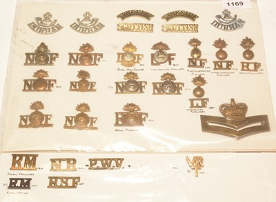Lot 1169 - A collection of 26 mainly Infantry metal shoulder titles.