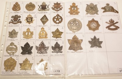 Lot 1172 - A collection of 27 Canadian K/C cap badges.