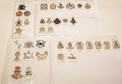 Lot 1189 - A collection of 36 African cap badges.