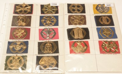Lot 1192 - A collection of 18 Dutch cap badges on felt backing.