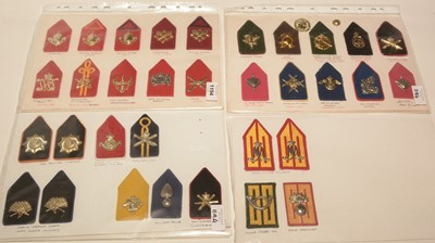 Lot 1194 - A collection of 33 Dutch collar badges on boards.
