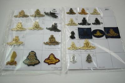 Lot 1201 - A collection of 26 Royal Artillery cap badges.