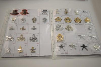 Lot 1204 - A collection of 33 Gurkha cap badges.