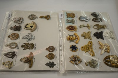 Lot 1206 - A collection of 33 South African miniature cap badges.