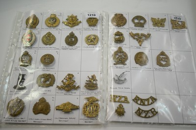 Lot 1210 - A collection of 32 New Zealand cap badges.