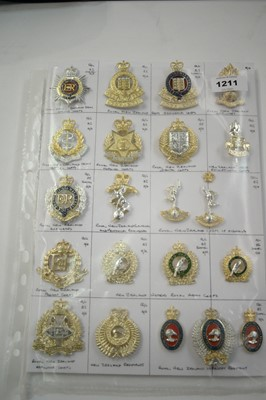 Lot 1211 - A collection of 21 New Zealand Military cap badges.