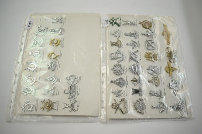 Lot 1212 - A collection of 48 Indian and Pakistani cap badges.