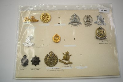 Lot 1214 - A collection of Indian and Pakistani cap badges.