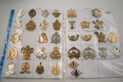 Lot 1218 - A collection 34 Belgian Infantry cap badges.