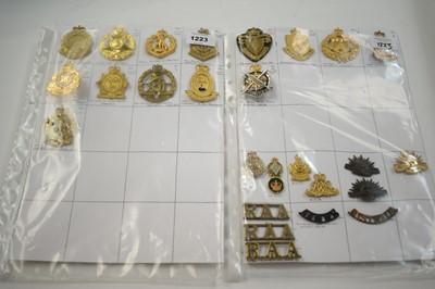 Lot 1223 - A collection of 26 Australian metal cap badges.