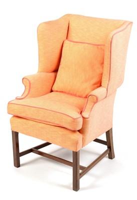 Lot 852 - A Georgian style wingback armchair