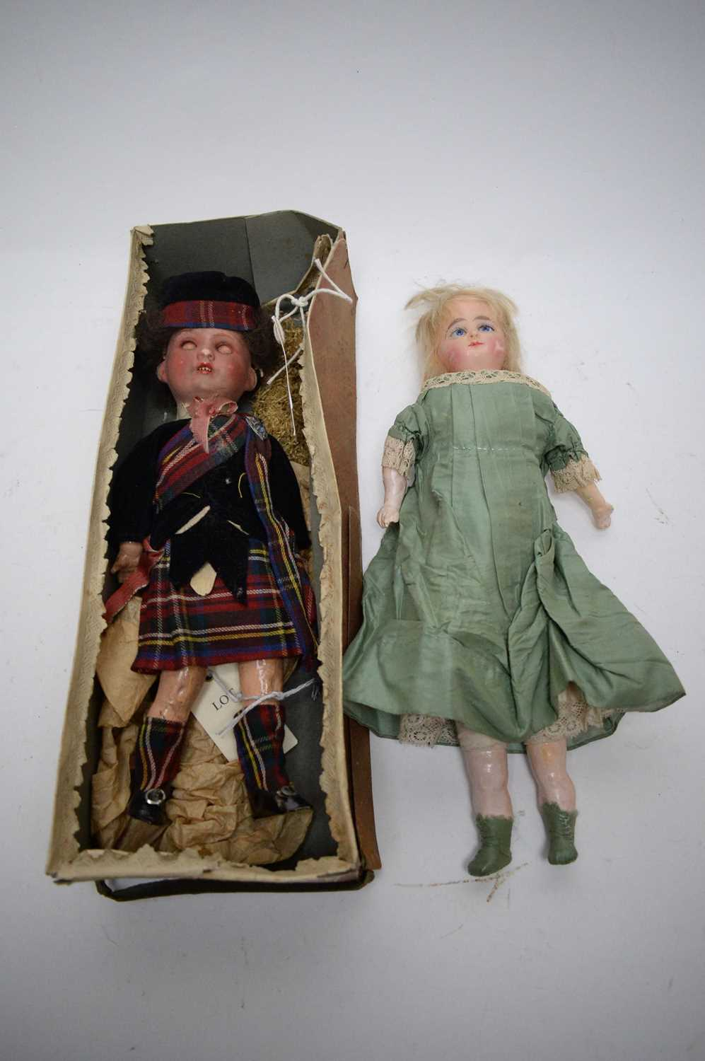 Lot 779 - Two dolls.