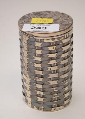 Lot 243 - Silver basket pattern pot.