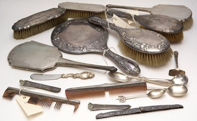Lot 247 - A selection of silver-backed dressing table items
