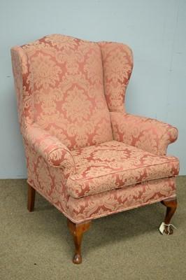 Lot 43 - 20th Century wingback armchair