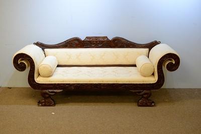 Lot 10 - A Regency style sofa.