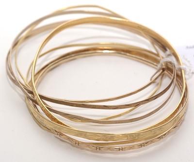 Lot 199 - Selection of yellow metal bangles.