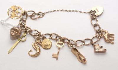 Lot 200 - 9ct. yellow gold charm bracelet.