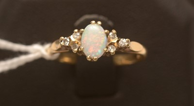 Lot 219 - Opal and diamond ring.