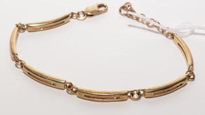 Lot 186 - Hot diamond 9ct. yellow gold bracelet.