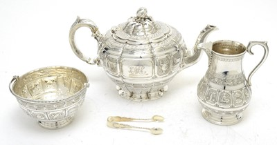 Lot 149 - A Victorian silver teapot, with associated sugar basket and milk jug; and sugar tongs.