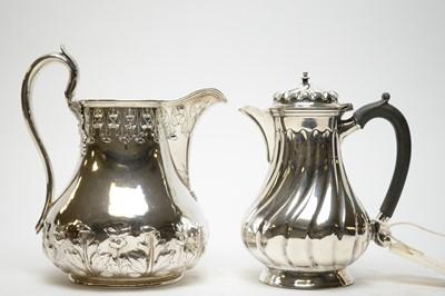 Lot 296 - Late Victorian silver hot water jug; and a Britannia metal water jug.