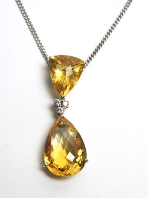 Lot 15 - A citrine and diamond drop pendant