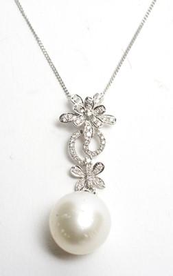 Lot 16 - A pearl and diamond pendant