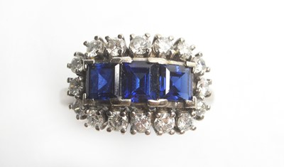 Lot 17 - A sapphire and diamond cluster ring