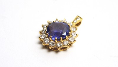 Lot 27 - A sapphire and diamond cluster pendant