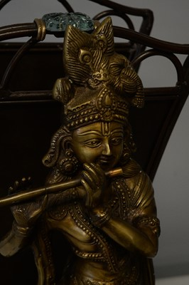 Lot 218 - Repro Indian brass deity; magazine rack; and Asian stand.