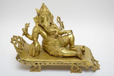 Lot 397 - Modern Indian gilt brass figure of Ganesh.