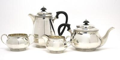 Lot 181 - A George V silver four-piece tea service.