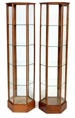 Lot 862 - Pair of Edwardian oak hexagonal display cabinets