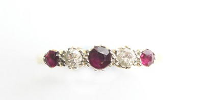 Lot 14 - A ruby and diamond ring