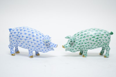 Lot 384 - Two Herend pig ornaments.
