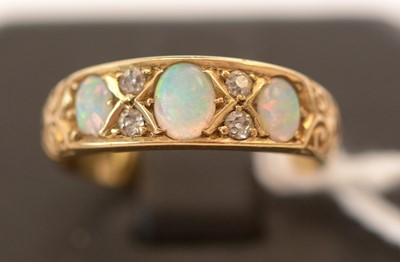 Lot 173 - Opal and diamond ring
