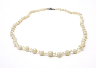 Lot 179 - A white opal bead and crystal necklace.