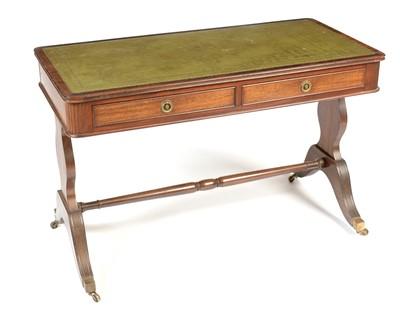 Lot 883 - Edwardian mahogany library table
