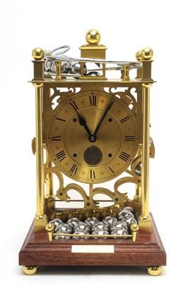 Lot 771 - A modern lacquered brass spherical weight clock.